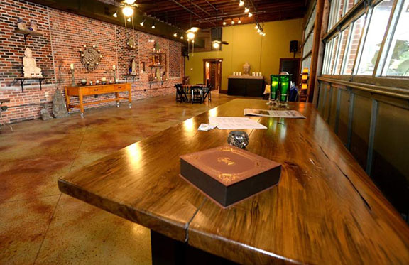 A former mechanics garage turned event venue. I was asked to help create a sacred space that was multifunctional enough to hold events ranging from yoga retreats to wedding receptions. To see more photos and read about this project, click on the Living Well link above.